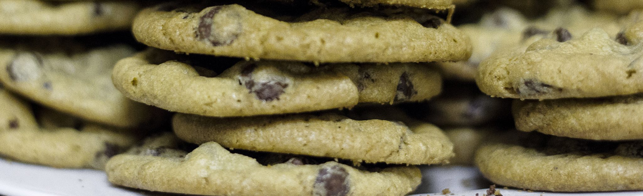 photograph of stacked chocolate chip cookies